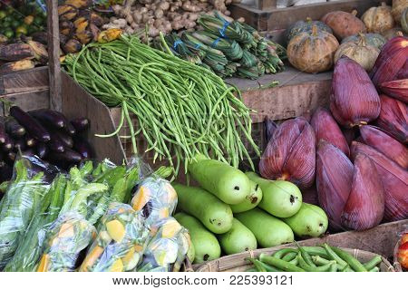 Local Fruit And Vegetables Market In El Nido, Palawan, Philippines. Long Beans, Eggplants And Banana