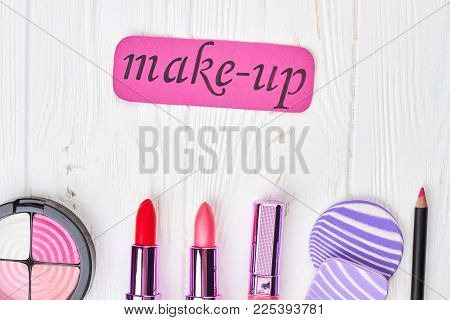 Set Of Make Up Products, Wooden Background. Palette Of Eyeshadow, Lipsticks, Puff And Pencil For Lip