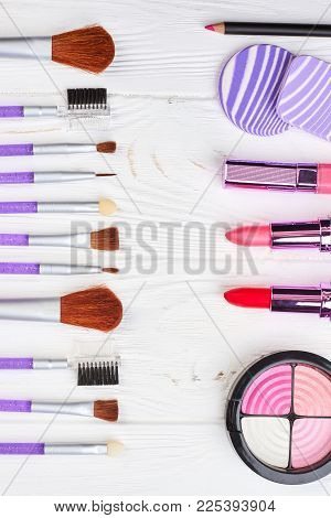 Make Up Brushes And Cosmetics Set. Decorative Cosmetics On White Wooden Background, Top View. Collec