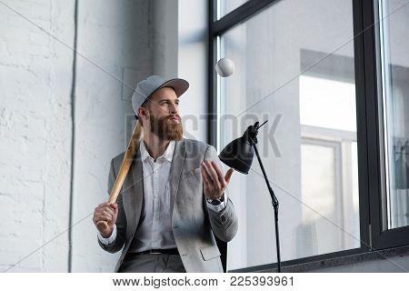 businessman throwing up baseball ball and holding baseball bat poster