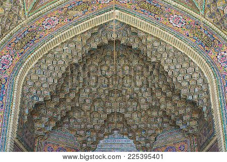 SHIRAZ, IRAN - JUNE 20, 2007: Beautiful old mosaic decorates exterior wall of the Nasir al-Mulk mosque in Shiraz, Iran.