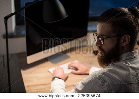 Businessman Typing Something On Keyboard In Office And Looking Away