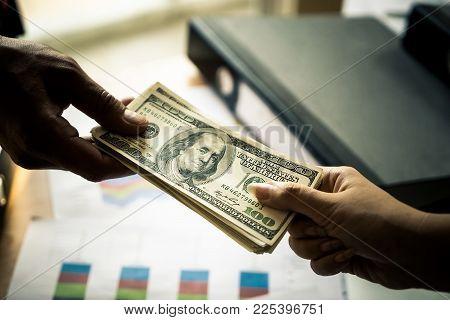 Business Man Hands Handing Money Over A Business Meeting
