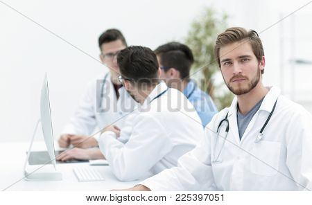 confident therapist, on the background of his colleagues