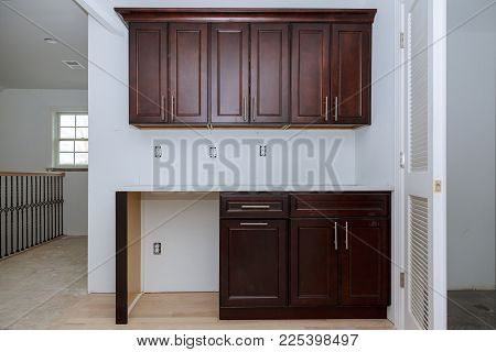 Installing new induction hob in modern kitchen cabinets installation