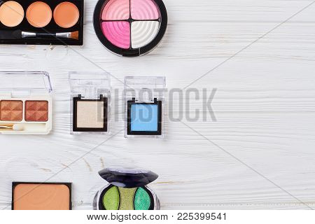 Eyeshadows Kit On White Wooden Background. Professional Make Up Eyeshadows And Copy Space. Fashion S