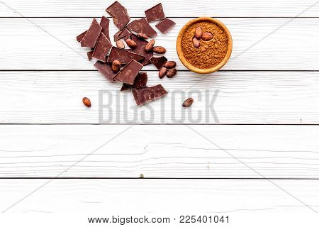Chocolate And Cacao Concept. Cocoa Powder In Bowl Near Cocoa Beans And Broken Chocolate On White Bac