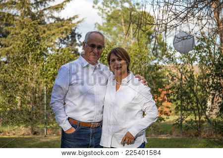 Senior Couple Posing While Having A Party At Home