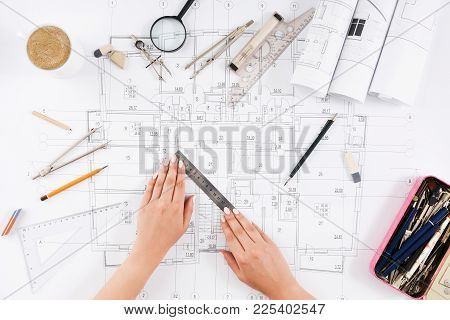 Architect Drawing Architectural Project. Top View On Unrecognizable Designer Hands Working With Buil