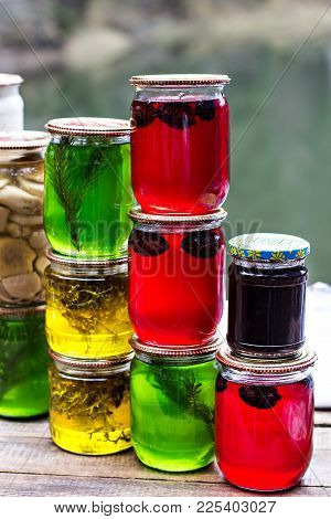 Multicolored Honey In A Jar On The Counter. Colored Jars With Sweet Honey Or Jam -   Green, Yellow