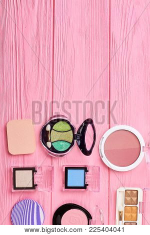 Set Of Shiny Eyeshadows, Top View. Blushers And Colorful Eyeshadows On Pink Background, Copy Space F
