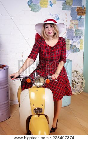Beautiful Happy Woman In Red Dress And White Hat Sitting On A Vintage Scooter