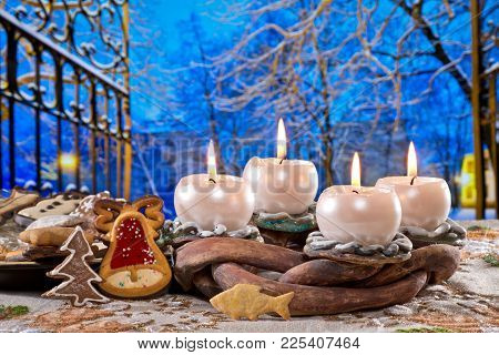 Advent Wreath With Burning Candles In  Front Of Winter Landscape