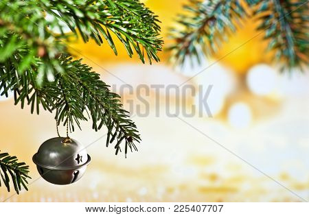 Christmas Bell With Christmas Twig On The Unfocused Background