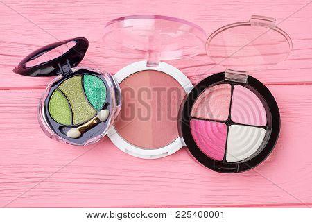 Eyeshadows Set On Pink Background. Make Up Long Lasting Facial Matte Blusher. Women Decorative Cosme