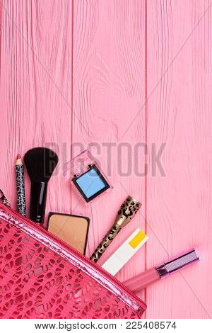 Cosmetics Bag With Makeup Products, Top View. Cosmetics And Makeup Tools In Pink Toiletry Bag, Copy