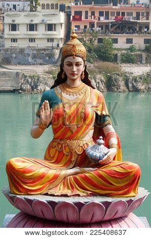 Rishikesh, India - November, 3rd, 2017. Statue Of Sitting Goddess Parvati On The Riverbank Of Ganga