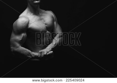 Strong Athletic Man. Handsome Fitness Model Showing Naked Torso, Muscular Body. Strong Hands, Chest