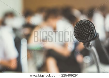 Microphone Voice Speaker With Audiences In Seminar Classroom, Lecture Hall Or Conference Meeting In