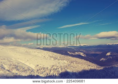 Panorama Of Mountains In Winter - Mountain Ranges Covered With Snow, Stretch To The Horizon Under A