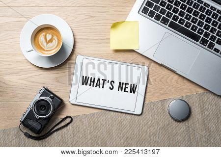 What's New Written On Tablet In Office As Flatlay