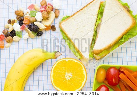Lunch Items Set With Vegetables In Green Lunch Box, Fresh Fruit, Candy Fruit And Sandwich , Top View