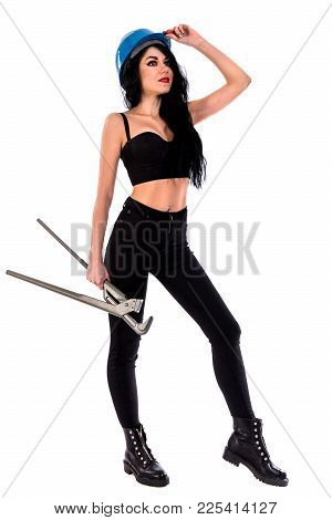 Pretty Young Woman With A Heavy-duty Straight Pipe Wrench Isolated Over White Background