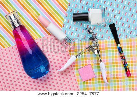 Cosmetics And Makeup Equipment. Fragrance Bottle, Lipstick, Eyelashes Curler. Eyeshadows On Patterne