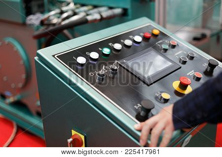 Operator Working With A Control Panel Of Modern Metalworking Machine. Selective Focus.