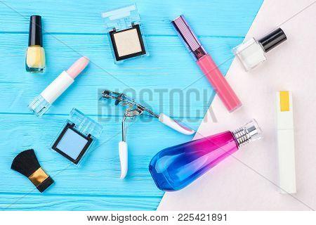 Decorative Cosmetics Set And Tools. Eyelashes Curler, Perfume, Nail Polish, Lipstick, Eyeshadows On