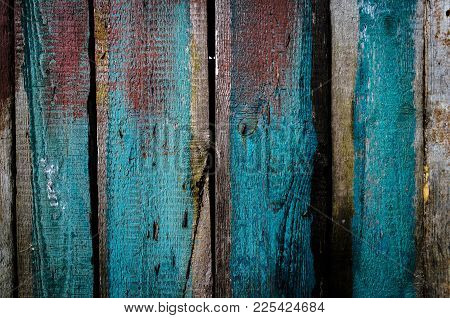 Grungy Blue And Red Pealing Paint Wooden Wall Texture.