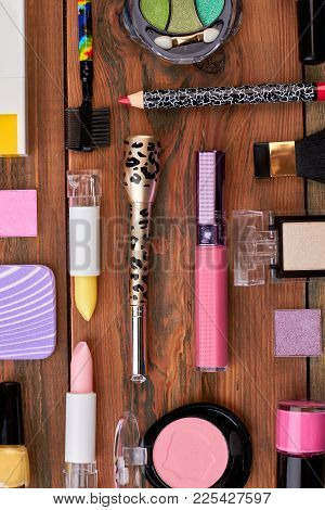 Colorful Cosmetics On Brown Workplace. Cosmetics Make Up Artist Objects, Top View. Fashion Design Co