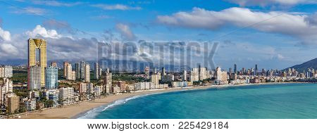 Wide View Of Benidorm Coastline With High Buildings, Mountains And Sea