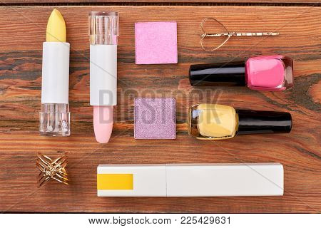 Flat Lay Cosmetics On Brown Wooden Background. Beautiful Composition Of Decorative Cosmetics And Jew