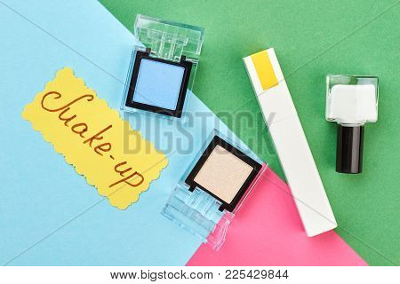 Decorative Cosmetics Set On Colorful Background. Fashion Makeup Products And Paper Card With Text Ma