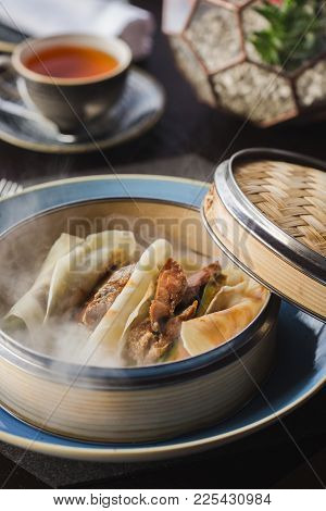 Pancakes With Peking Duck And Hoisin Sauce On The Basket. Dry Ice. Russian Maslenitsa.