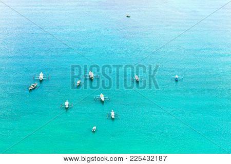 Traditional filipino boats in El Nido bay aerial view