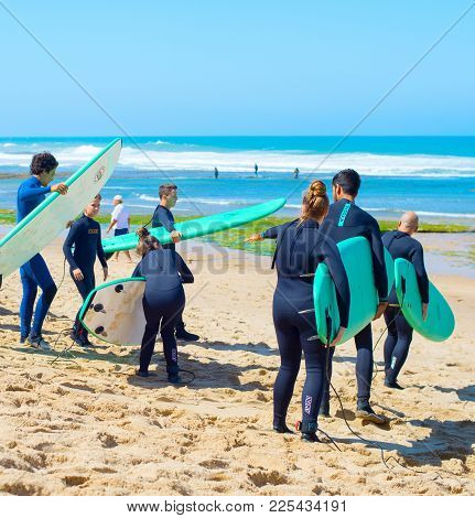 Group Of Surfer Going Surfing