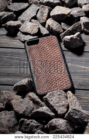 Exclusive Brown Snake Leather Case For Smartphone,luxury Case. On Stone Background