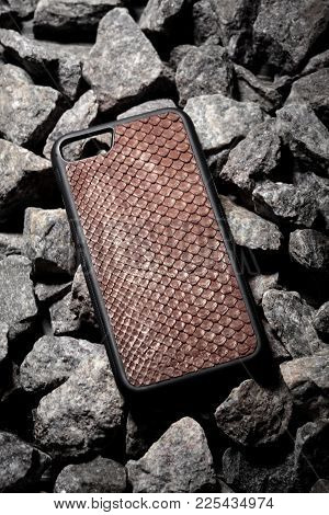 Exclusive Brown Snake Leather Case For Smartphone.luxury Case. On Stone Background