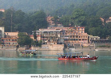 Rishikesh, India - November, 3rd, 2017. Beautiful View Of Ganga River Embankment In Rishikesh. Peopl