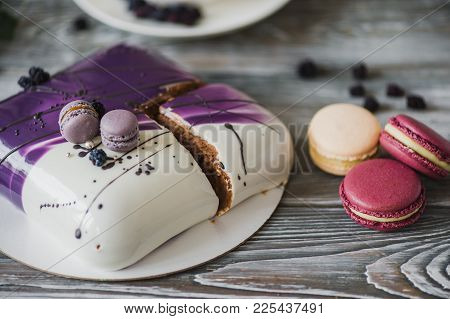 Details Of A Wedding Or A Birthday Purple Cake, In Studio On Wooden Background. Purple Small Macaron