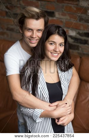 Vertical Portrait Of Smiling Attractive Young Couple Looking At Camera, Cheerful Millennial Casual M