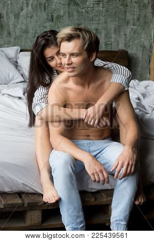 Beautiful Woman Embracing Handsome Sexy Guy With Naked Torso, Young Loving Girl Hugging Man Sitting