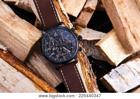 Watch Mens Brown Leather Strap On Wood. Black Dial. Knife With Orange Handle