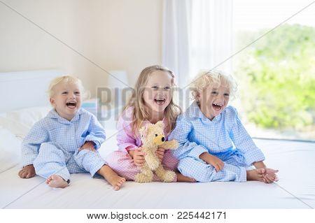 Kids In Bed. Children In Pajamas. Family Bedroom.