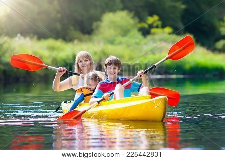 Kids Kayaking In Ocean. Children In Kayak In Tropical Sea. Active Vacation With Young Kid. Boy And G