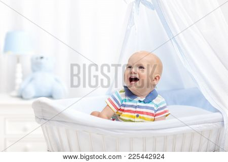 Baby Drinking Milk. Boy With Formula Bottle In Bed