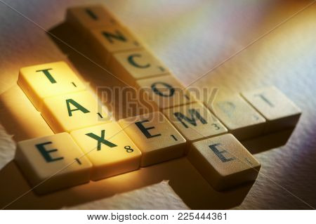 Cleckheaton, West Yorkshire, Uk: Scrabble Board Game Letters Spelling The Words Tax Income Exempt ,1