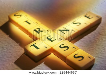Cleckheaton, West Yorkshire, Uk: Scrabble Board Game Letters Spelling The Words Stress, Tense, 1st J